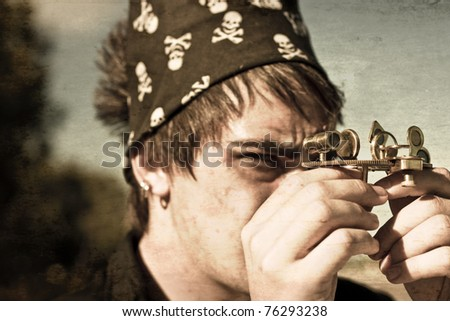 Textured Grunge Photo Of A Sailor Searching The Distant Horizon When Looking Through The Viewfinder Of A Olden Day Brass Navigation Instrument