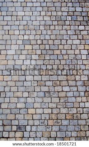 Textured image of cobblestone road. Background - stock photo