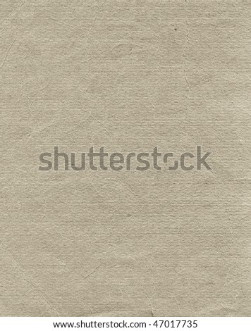 Textured obsolete paper with natural fiber parts - stock photo