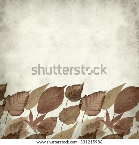 textured old paper background with autumnal leaves
