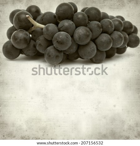 textured old paper background with black  grapes - stock photo