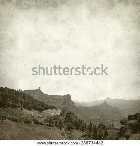 textured old paper background with canarian pine trees and Roque Nublo - stock photo