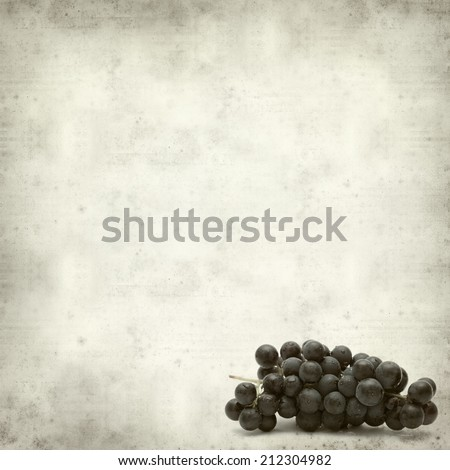 textured old paper background with dark grapes - stock photo