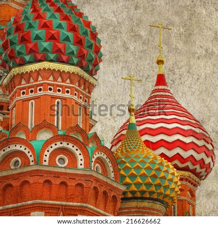 Textured old paper background with Fragment of the Cathedral of Saint Basil the Blessed at the Red Square of Russia in Moscow .Image in retro style  - stock photo