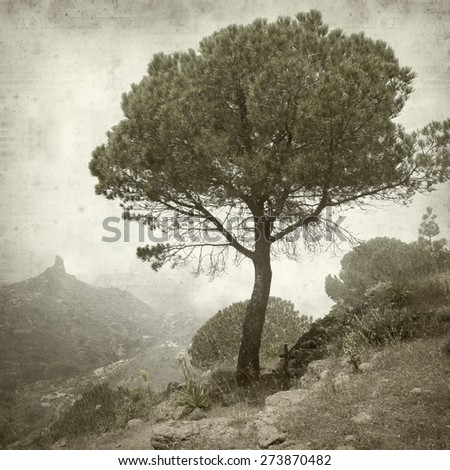 textured old paper background with landscape of Gran Canaria - stock photo