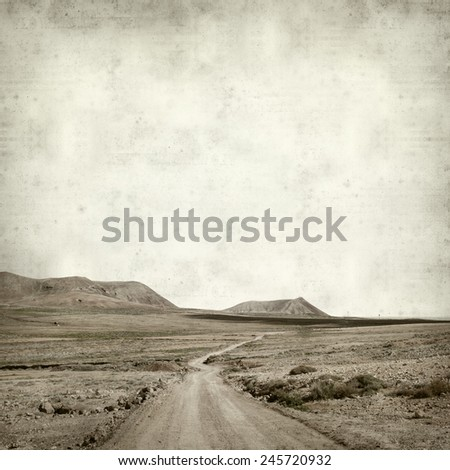 textured old paper background with mountains of Fuerteventura - stock photo