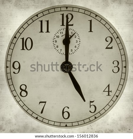 textured old paper background with old fashioned alarm clock
