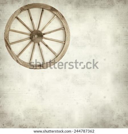textured old paper background with old wagon wheel