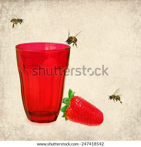 Textured old paper background with red drink glass, only ripe strawberry and honeybees. Paper texture image - stock photo
