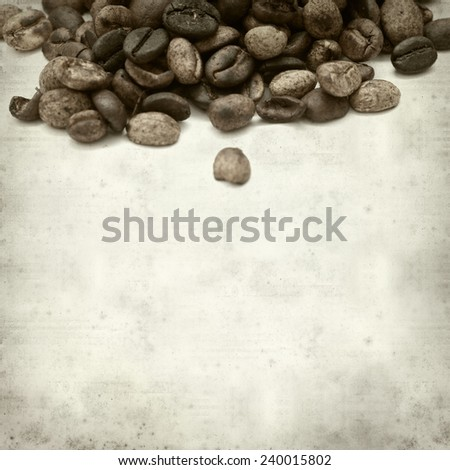 textured old paper background with speciality coffee grain - stock photo