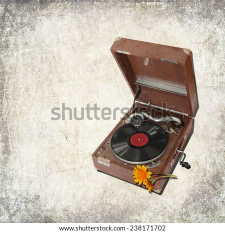 Textured old paper background with the ancient record player.  Paper texture. Aged textured photo in vintage style   - stock photo