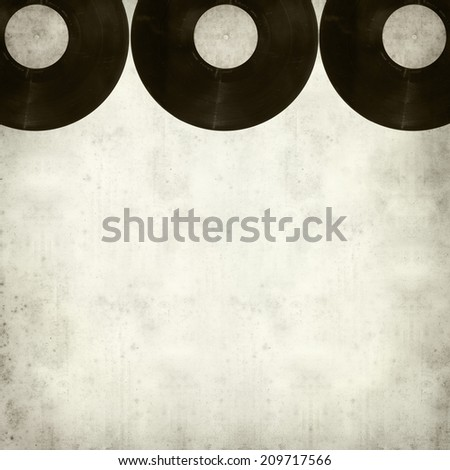 textured old paper background with vinyl disc - stock photo