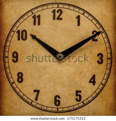 Textured old paper clock face showing 10:10 - stock photo