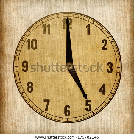 Textured old paper clock face showing 5 o'clock - stock photo