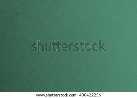 Textured paper sheet background dark green color for cards and other design ideas - stock photo