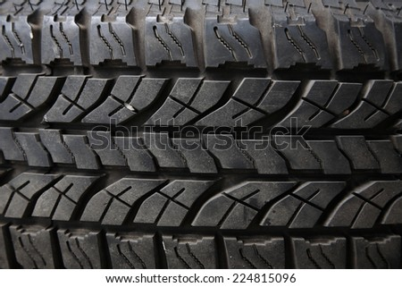 Textured pattern of a new truck tire background - stock photo