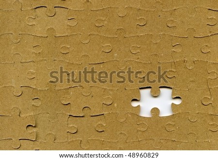 textured puzzle with missing piece - stock photo