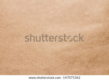Textured recycled brown vintage paper with natural fiber parts texture background. - stock photo
