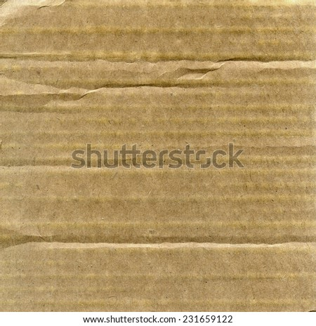 Textured recycled cardboard with natural fiber parts - stock photo