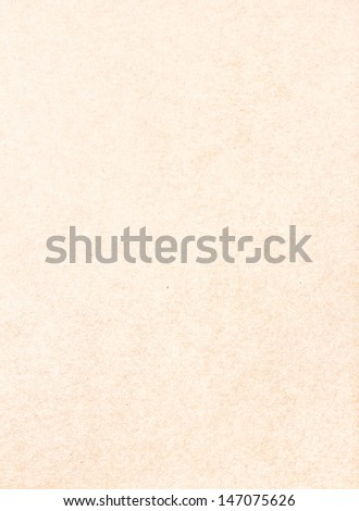 Textured recycled  natural  paper background with natural fiber parts, light beige color - stock photo