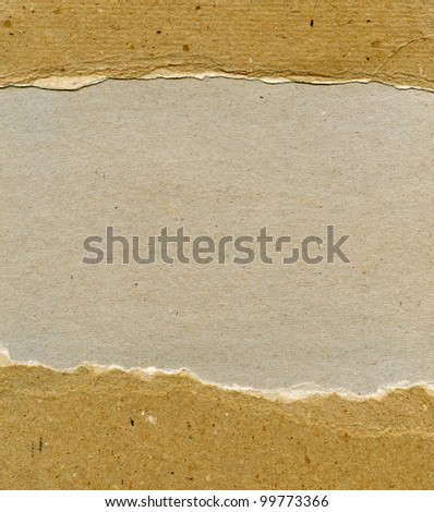 Textured recycled rough torn paper with natural fiber parts - stock photo