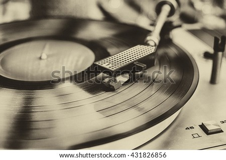 Textured retro image in sepia of vinyl record player. - stock photo