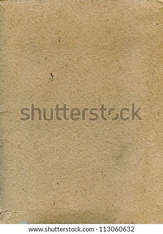 Textured rough grainy recycled paper with natural fiber parts - stock photo