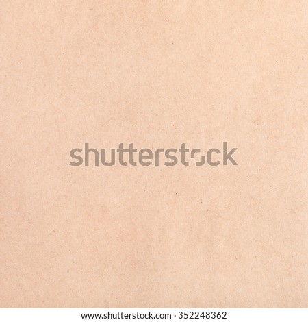 textured square background from brown crumpled kraft paper