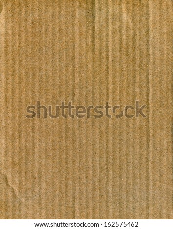 Textured striped recycled cardboard with natural fiber parts - stock photo