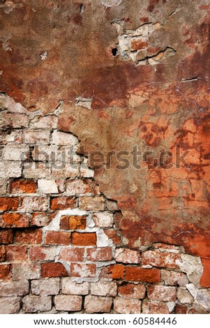 Textured wall with brick and stucco - stock photo