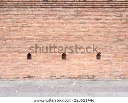 thai ancient brick wall - stock photo