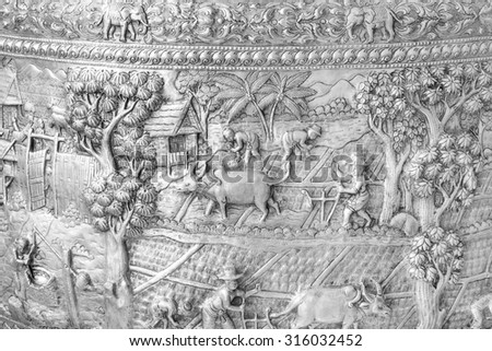 Thai Antique of engraved silver pattern for background  on curve wall, Decorative Art of Lanna Thai. - stock photo