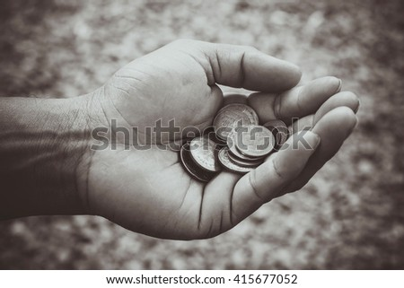 Thai Baht Coins in hand - stock photo