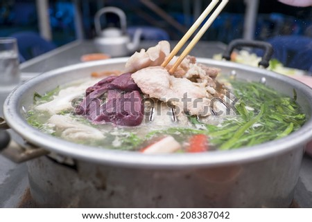 Thai barbecue and spicy soup - stock photo