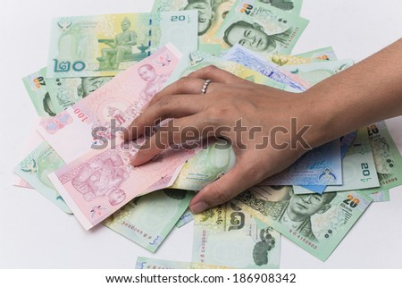 Thai bath close up of money with hand that use in Thailand - stock photo