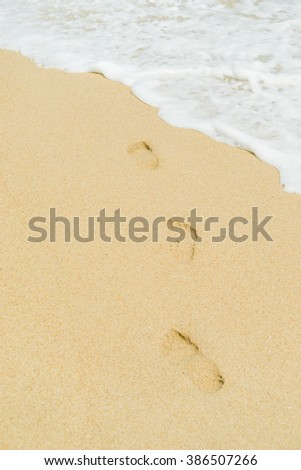 Thai beach, wave and footsteps - stock photo