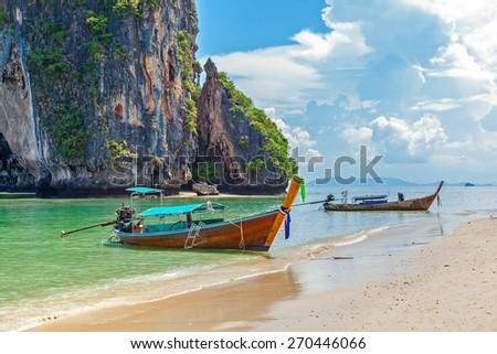 Thai boat on Railay beach in Krabi - stock photo