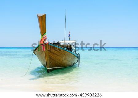 Thai boat on the beach, Andaman sea, Koh Rok island, Thailand - stock photo