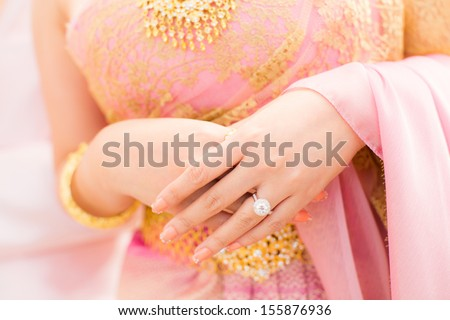 Thai bride with wedding ring