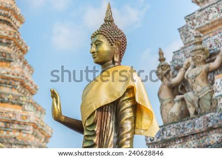 Thai Buddha a stupa, Golden sculpture, Wat Arun temple in Bangkok, Thailand. - stock photo