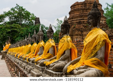 Thai Buddha statue in Wat Yai chai mong kol , Ayutthaya Thailand ancient capital of Thailand. This is traditional and generic style in Thailand. No any trademark or restrict matter in this photo. - stock photo