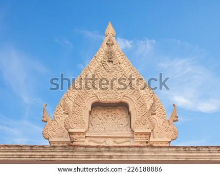 Thai Buddhist temple ancient style stucco gable - stock photo