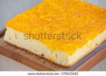 Thai Cake sweetmeat made of egg yolk on wooden table.