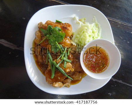 Thai chicken and rice dish with gravy in a restaurant in Bangkok, Thailand. - stock photo