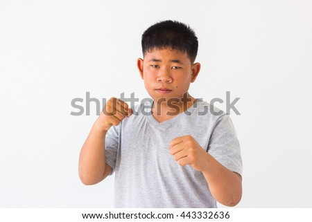 Thai child boxer on blank background. muay thai.