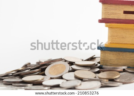 thai coin and money box  on white paper background