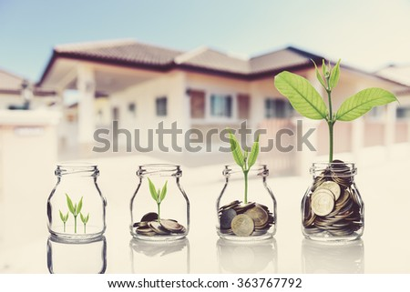 Thai coins and seed in bottle on blurred home background,Business investment growth concept,saving concept,vintage tone style - stock photo