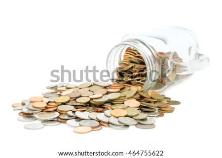 Thai Coins in glass isolated on white background.