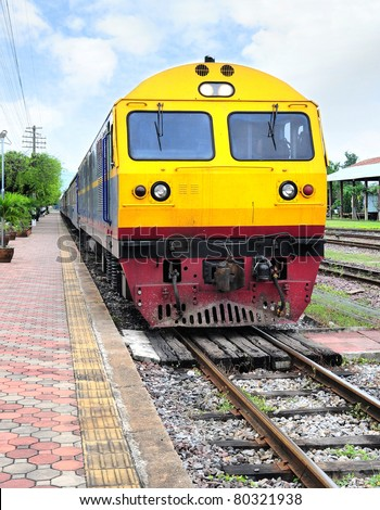 Thai colorful train arriving at station - stock photo