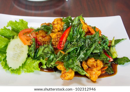 Thai Crispy Fried Chicken with Basil Leaves Bell Pepper Cucumber Tomato Dish - stock photo